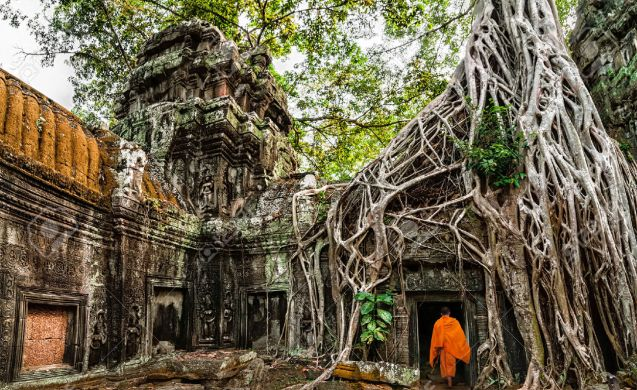 29657363-buddhist-monk-at-angkor-wat-ancient-khmer-architecture-ta-prohm-temple-ruins-hidden-in-jungles-popul-stock-photo